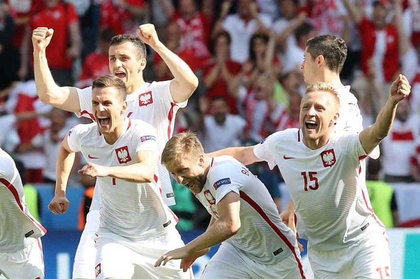 Poland's players celebrate their team's win.