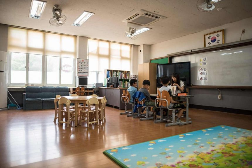 Pupils attending class at Seoksan Elementary School in Gunwi, which is about 200km south of Seoul.