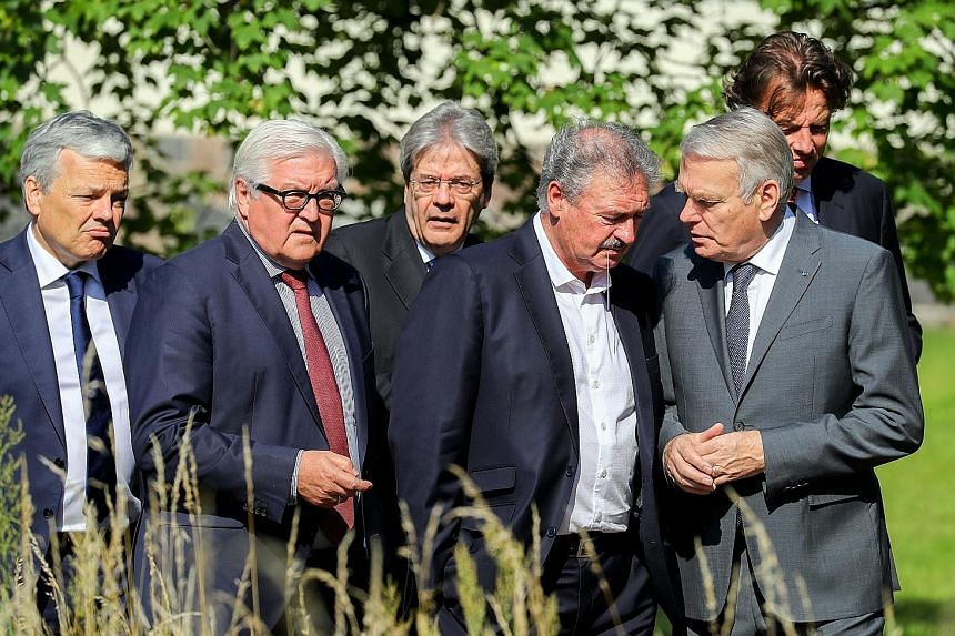 Foreign ministers of the six original states of the European Union - (from left) Belgium's Didier Reynders, Germany's Frank-Walter Steinmeier, Italy's Paolo Gentiloni, Luxembourg's Jean Asselborn, France's Jean-Marc Ayrault and the Netherlands' Bert