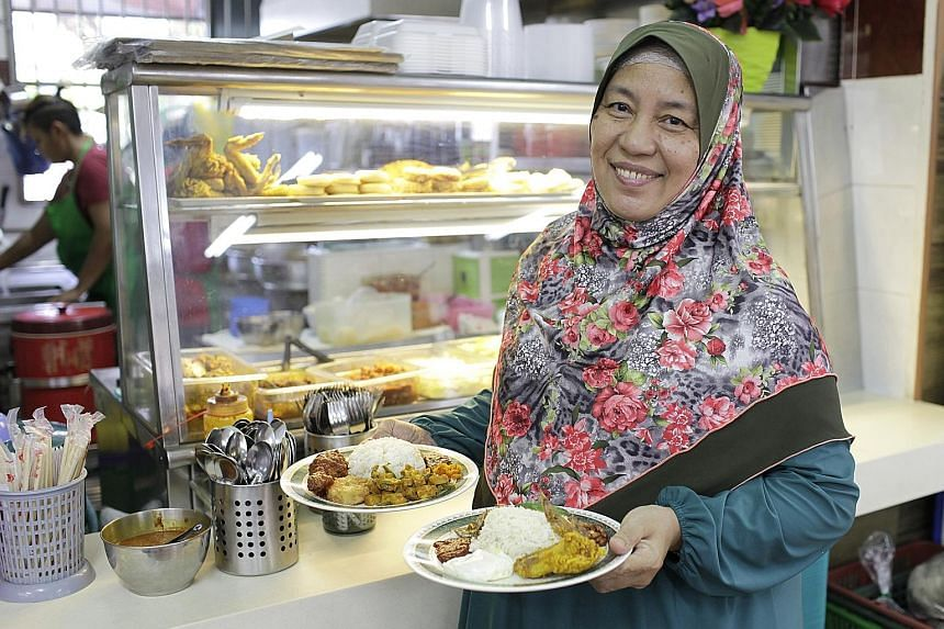Jumi's Kitchen owner Yunaina Taib (left) uses a mix of white, basmati and brown rice in some dishes at her stall. Healthy Carbs' chef Ang Seng Guan with the stall's two brown rice dishes - saba fish with brown rice (left) and teriyaki chicken with br