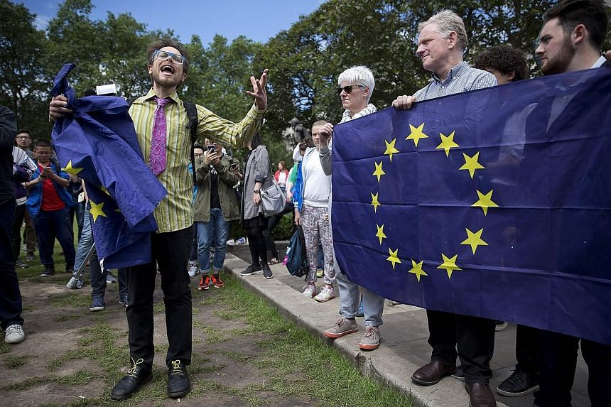 British demonstrators holding EU flags as they protested yesterday against the outcome of the Brexit referendum. The Leave camp won the support of 51.9 per cent of voters, against 48.1 per cent in favour of the Remain camp. The turnout for last Thurs