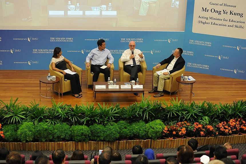 (From left in photo) ST senior education correspondent Sandra Davie, Acting Education Minister (Higher Education and Skills) Ong Ye Kung, SMU president Arnoud De Meyer and ST deputy editor Ignatius Low engaging in a lively discussion with the audienc