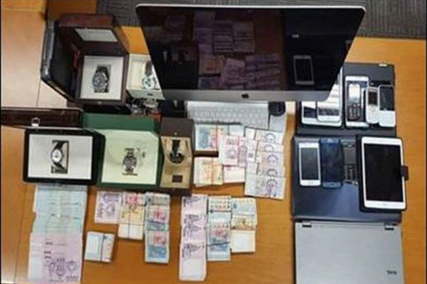 Police officers seized about $251,000 in cash, an array of computers, mobile phones and other documents such as betting records during the raids.