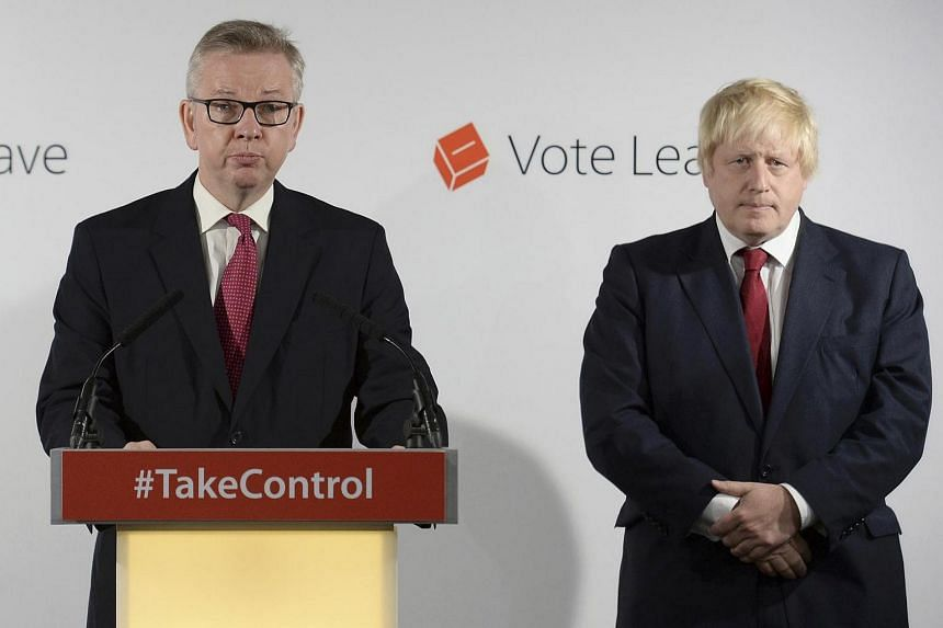 Britain's Justice Secretary Michael Gove (left) speaks as Vote Leave campaign leader Boris Johnson listens at the group's headquarters in London, Britain on June 24.