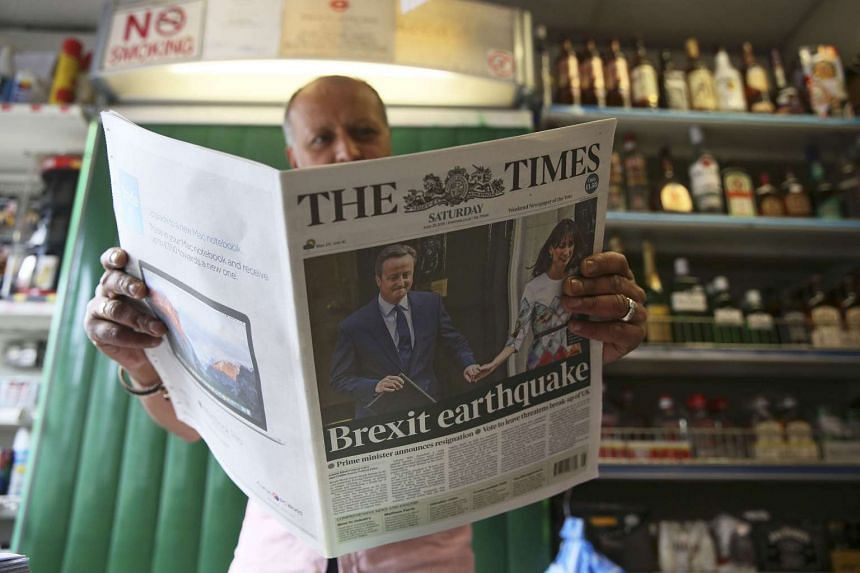 A man reads a newspaper the day after Britain voted to leave the EU, at a newsagents in central London, Britain June 25, 2016.