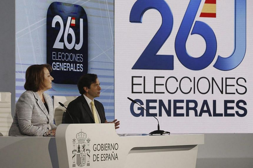Spanish Undersecretary of Communication Carmen Martinez Castro (left) and Assistant Secretary of Interior Luis Aguilera attend a press conference on the eve of the Spanish General Elections.