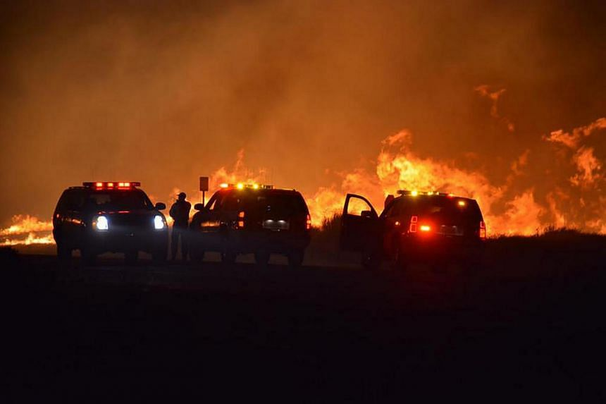 Emergency vehicles seen at the Erskine Fire near Lake Isabella, California, late on June 23. The fast-spreading wildfire has causes two deaths, destroyed some 100 structures and burned 30,000 acres in Kern County.