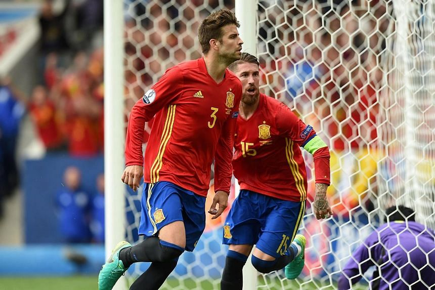 Spain's defender Gerard Pique (left) and Spain's defender Sergio Ramos celebrate after Pique scored the opening goal during their Euro 2016 group D match between Spain and Czech Republic.