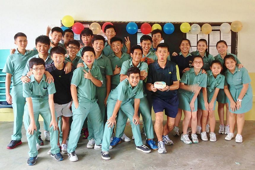 Mr Tang at a farewell party with his Ang Mo Kio Secondary School students in 2013.  He left the school to go into fitness coaching.