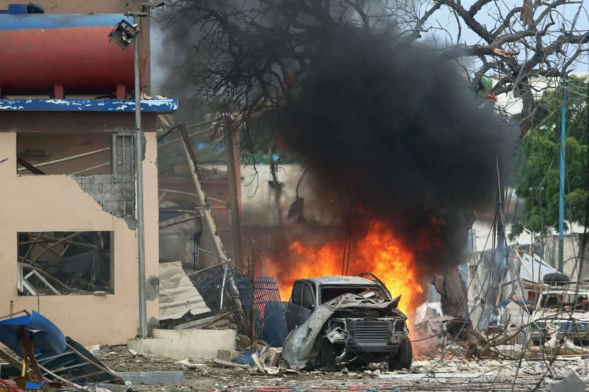 A vehicle burns at the scene of a suicide bomb attack outside Nasahablood hotel in Somalia's capital Mogadishu, June 25, 2016.
