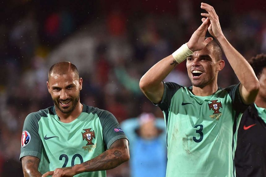 Portugal's defender Pepe (right) and forward Ricardo Quaresma celebrate at the end of the match.