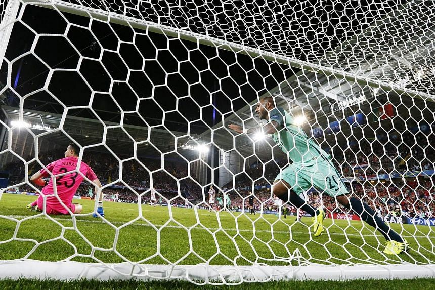 Ricardo Quaresma (centre) of Portugal celebrates after scoring the winning goal during the Uefa Eurp 2016 round of 16 match between Croatia and Portugal.