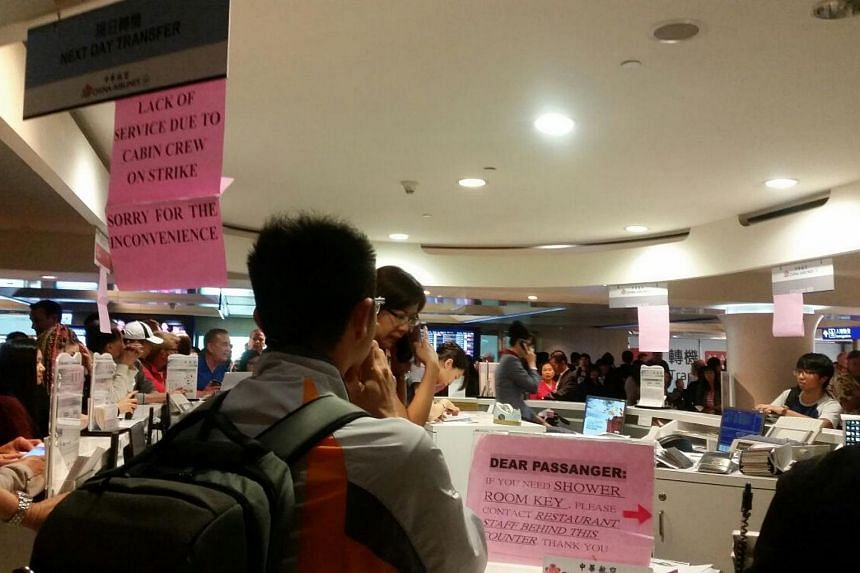 Makeshift signs put up at China Airlines' counters at Taoyuan airport to inform passengers of the strike.