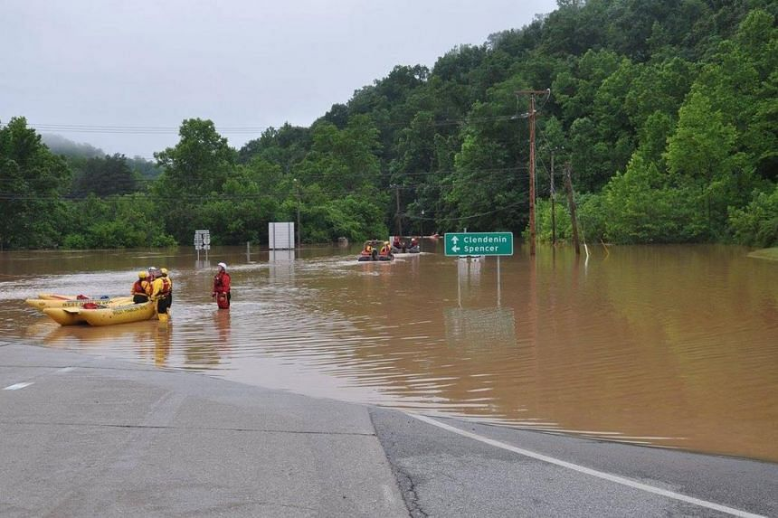 Emergency crews take out boats on a flooded I-79 at the Clendenin Exit, West Virginia, after the state was pummeled by rain on Thursday.