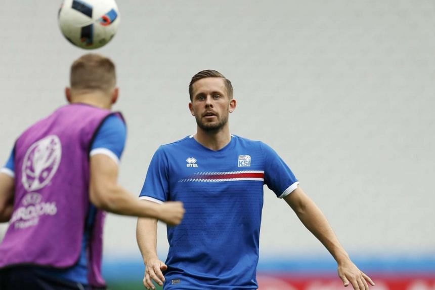 Iceland's Gylfi Sigurdsson (right) during training on June 21, 2016.