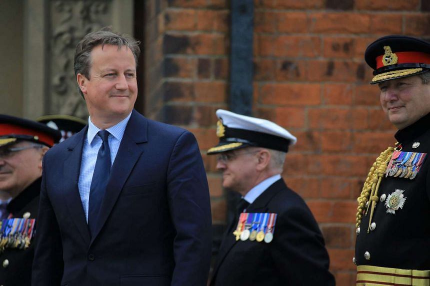 A photo provided by the British Ministry of Defence of British Prime Minister David Cameron, the day after his resignation following the Brexit win in the referendum, attending the Armed Forces Day Parade in the coastal town of Cleethorpes in Lincoln