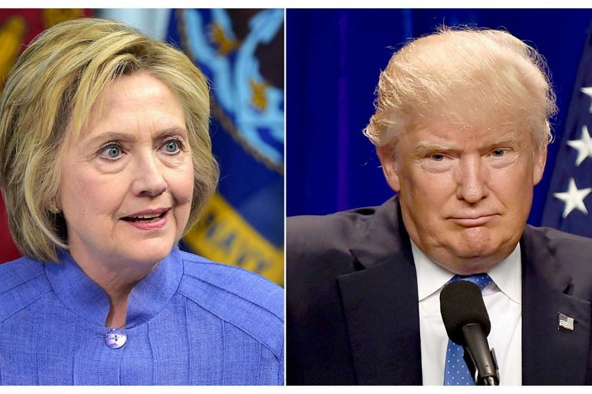 This combination of file photos shows Democratic presidential candidate Hillary Clinton(L)on June 15, 2016 and presumptive Republican presidential nominee Donald Trump on June 13, 2016.