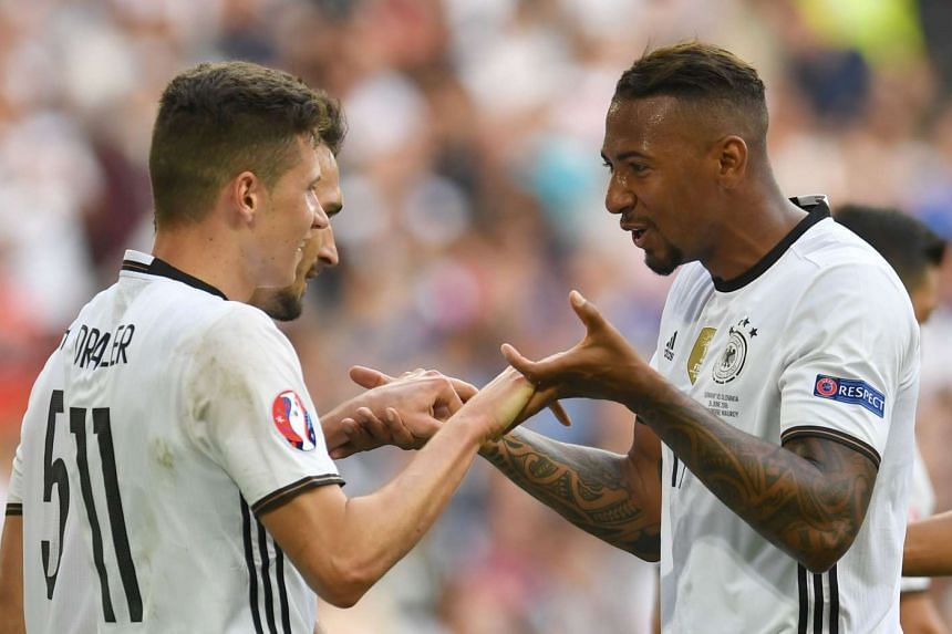 Germany's midfielder Julian Draxler (left) and Germany's defender Jerome Boateng celebrate their team's second goal during the Euro 2016 round of 16 football match between Germany and Slovakia at the Pierre-Mauroy stadium in Villeneuve-d'Ascq near Li