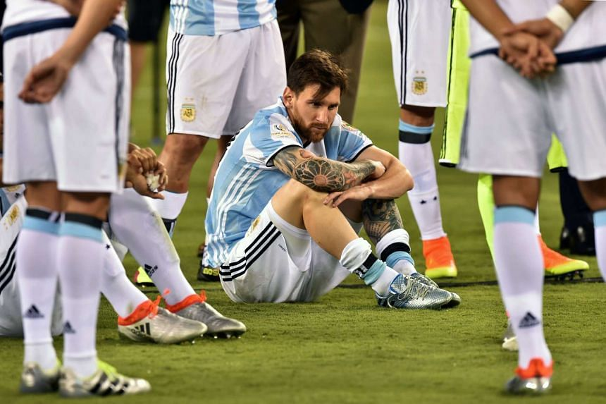 Argentina captain Lionel Messi waits to receive the second place medal after the Copa America final in East Rutherford, New Jersey, on June 26, 2016.