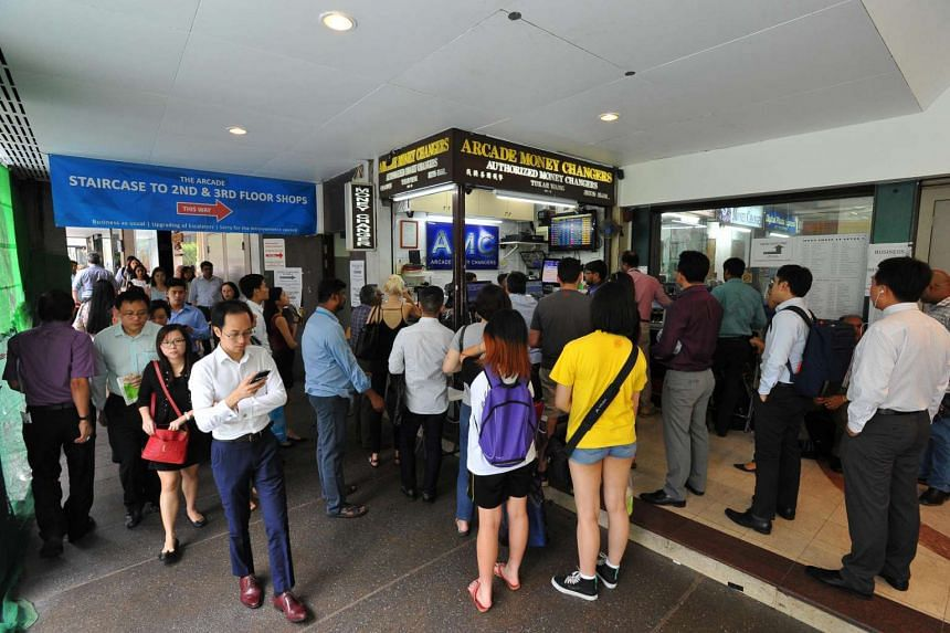 People queueing at Arcade Money Changers at The Arcade at Raffles Place on June 27 2016.