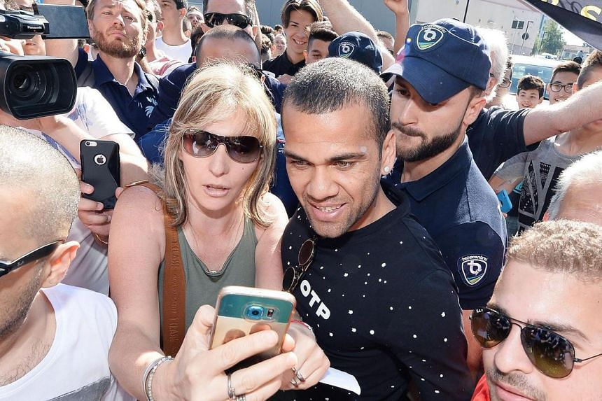 Dani Alves is surrounded by fans as he arrives at J-Medical for a medical check up, in Turin, Italy, on June 27, 2016.