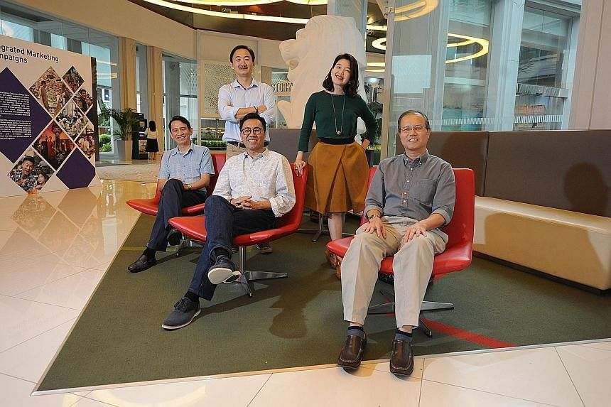 The team behind Wegogo: (seated, from left) Mr Tan, Mr Wong and Mr Mak; and (standing, from left) Mr Yue and Ms Ho-Phang. The start-up is an online platform for small travel service providers here and worldwide to sell directly to Chinese travellers.