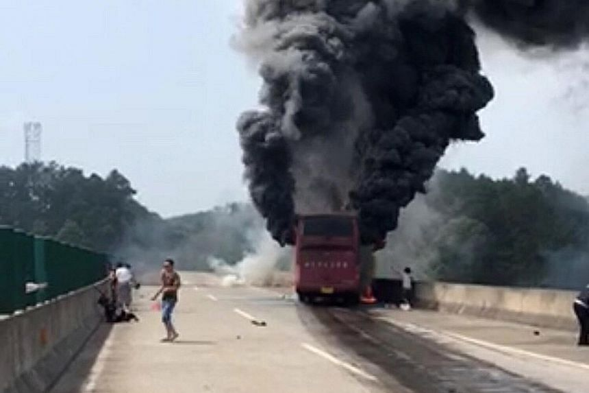 A total of 55 people were on board the bus that burst into flames after crashing in Hunan province. The driver has been detained.