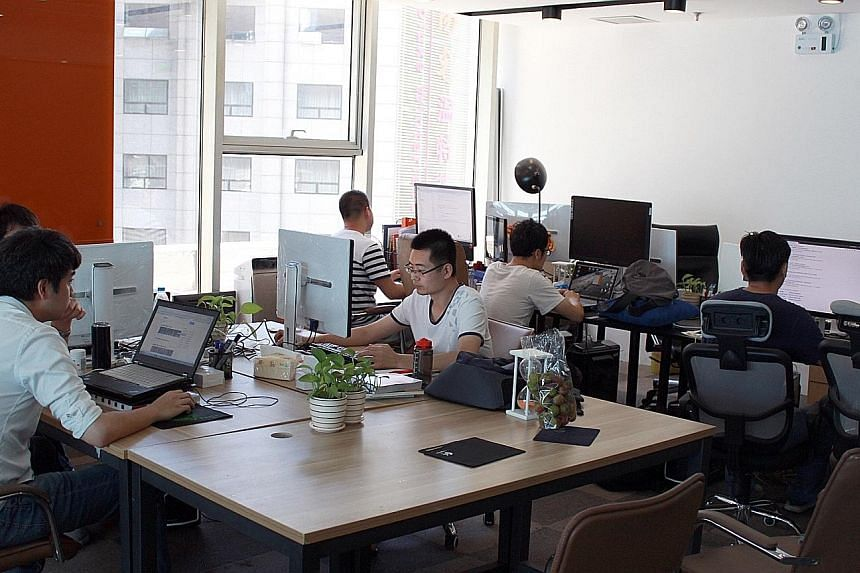 Staff at Beijing-based tech start-up ABD Entertainment. Many such firms have been drawing substantial investments from the government and venture capitalists, even amid China's slowing economy.