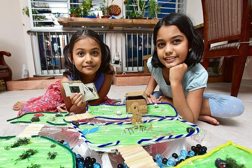 Sophia (left) and Anjali with the board game Sophia built for the Maker Faire. Anjali built a story garden depicting scenes from popular fairy tales. They were the youngest participants.