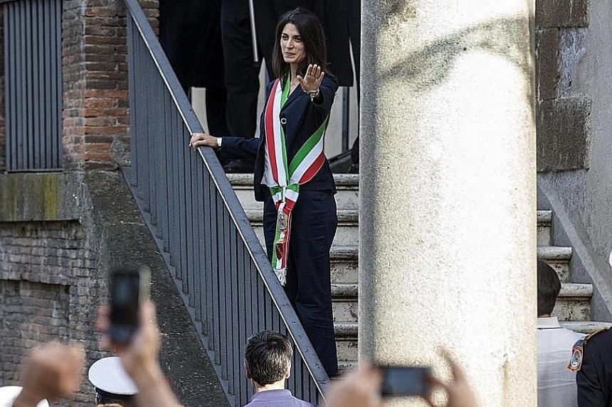 Ms Virgina Raggi, Rome's first female mayor and its youngest ever, waving to supporters at the Campidoglio Palace last Thursday.
