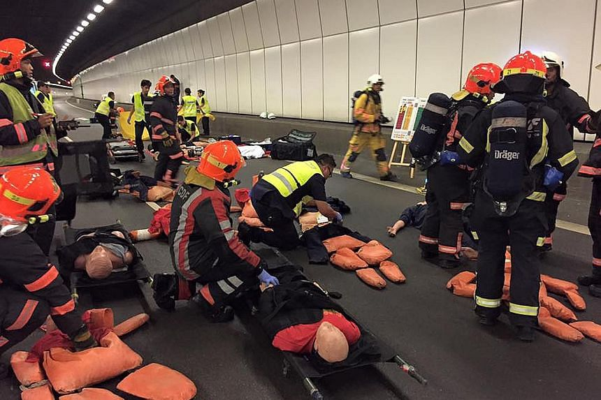 """Paramedics and medical personnel rushed to the aid of """"casualties"""" of a traffic accident on the Kallang-Paya Lebar Expressway (KPE) in the wee hours of yesterday morning in a simulated scenario that tested their emergency response skills. The 90-minu"""