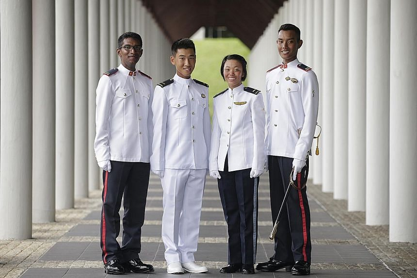 Mr Muhammad (far right) with fellow commissioned officers (from left) Kishan Kumar Thamilchelvan, Koh Jack and Ms Lee.