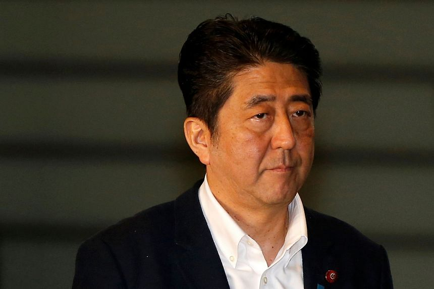Japan's PM Shinzo Abe arrives at his official residence to attend a meeting to discuss Britain's exit from the European Union, in Tokyo, Japan, on June 24.