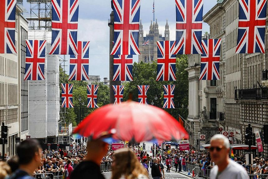 Union flag banners hang across a street near the Houses of Parliament in central London.