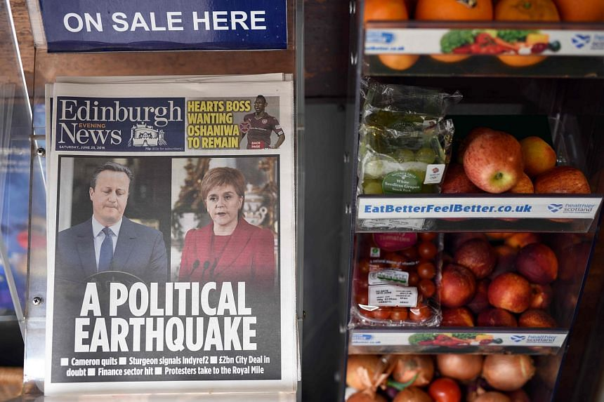 Newspaper front pages showing photos of British Prime Minister David Cameron and Scotland's First Minister and Scottish National Party leader Nicola Sturgeon on June 25.