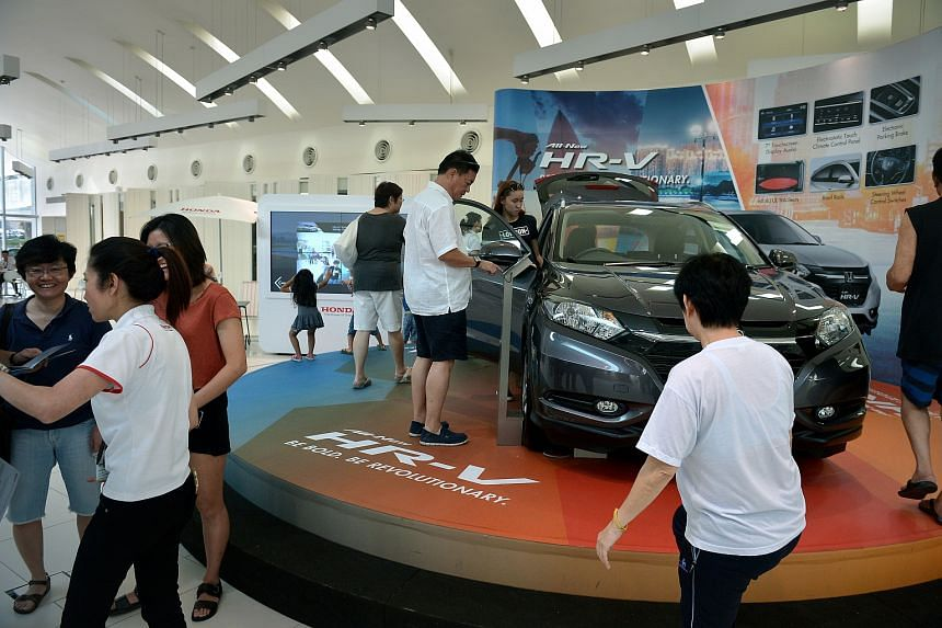 Car buyers at a showroom at Leng Kee Road on January 10.