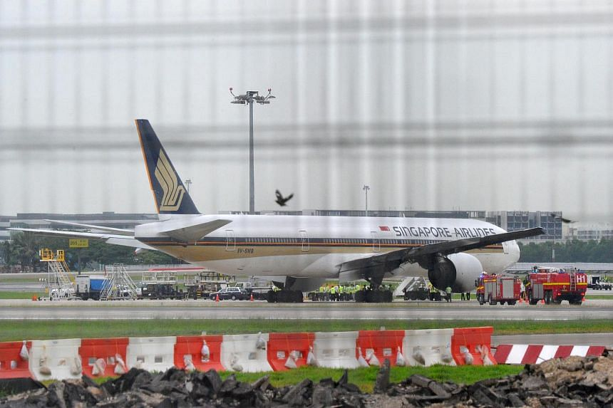 The Singapore Airlines Boeing 777 plane on the runway of Changi Airport Terminal 2 on June 27, 2016.