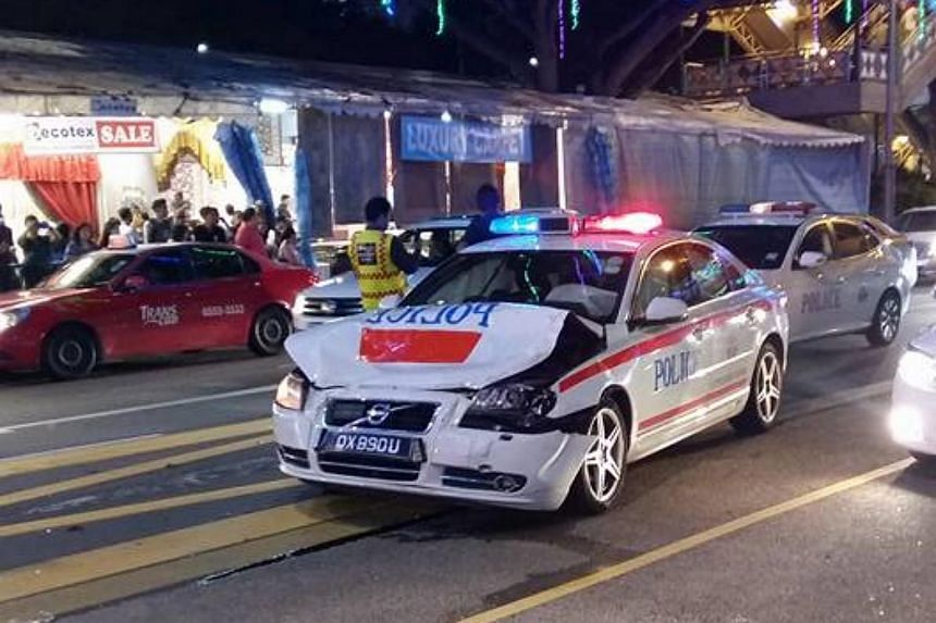 The front and hood of the Traffic Police patrol vehicle was badly dented after the collision.