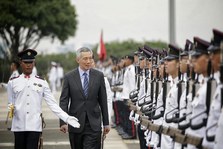 Prime Minister Lee Hsien Loong inspects the Officer Cadet Course Commissioning Parade at SAFTI Military Institute on June 26, 2016.