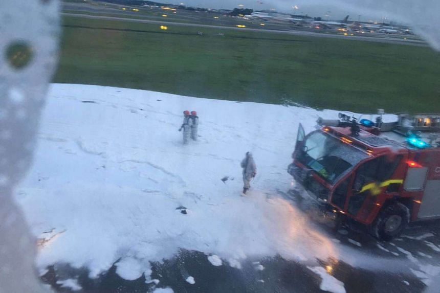 Firefighters used foam to put out the fire on flight SQ368 that caught fire on the runway at Changi Airport on Monday (June 27) morning.