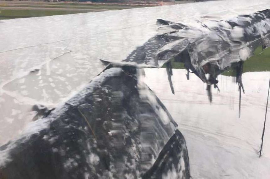 Damaged right wing seen on flight SQ368 that caught fire on the runway at Changi Airport on Monday (June 27) morning.