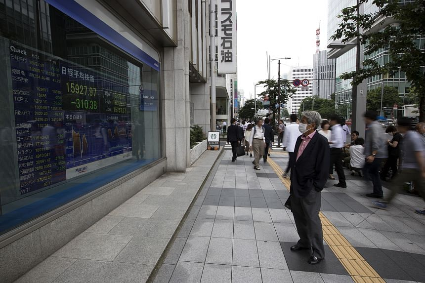 A man looks at an electronic stock board outside a securities firm in Tokyo.