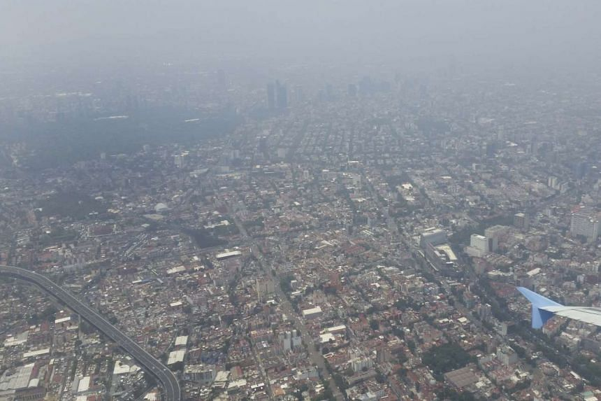 An aerial view of Mexico City covered by a layer of smog on May 30, 2016.