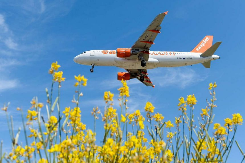An Easyjet airplane prepares to land at Barcelona's airport on June 6, 2016.