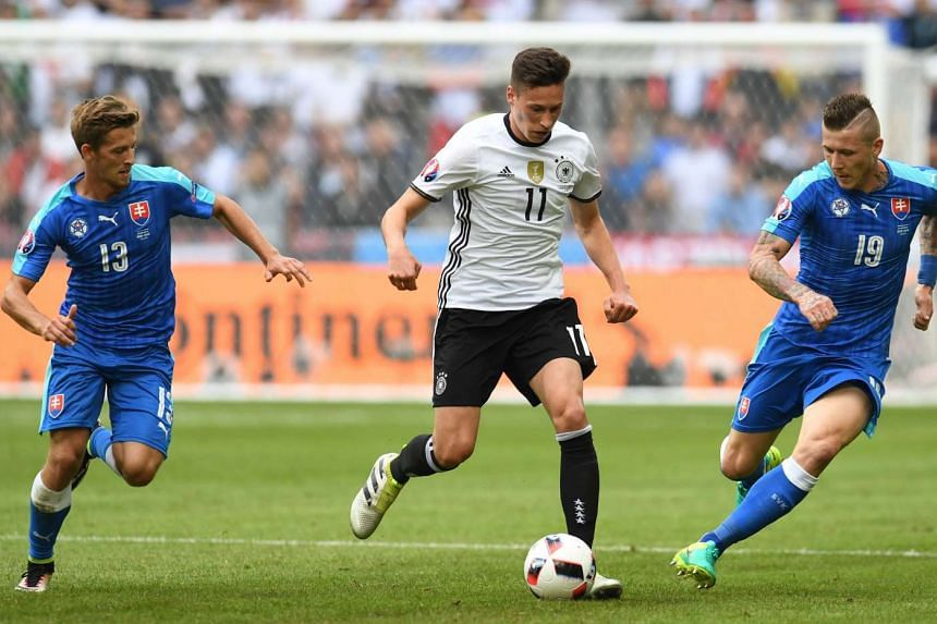 Germany's midfielder Julian Draxler (centre) during the Euro 2016 round of 16 match between Germany and Slovakia at the Pierre-Mauroy stadium on June 26, 2016.