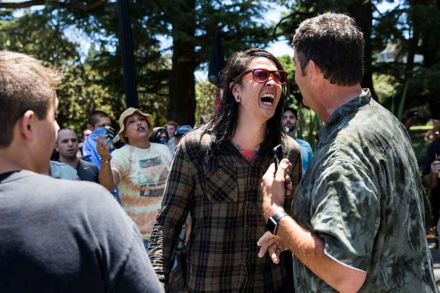 A protestor confronts a man during a clash between neo-Nazis holding a permitted rally and counter-protestors in Sacramento, California, on June 26, 2016.