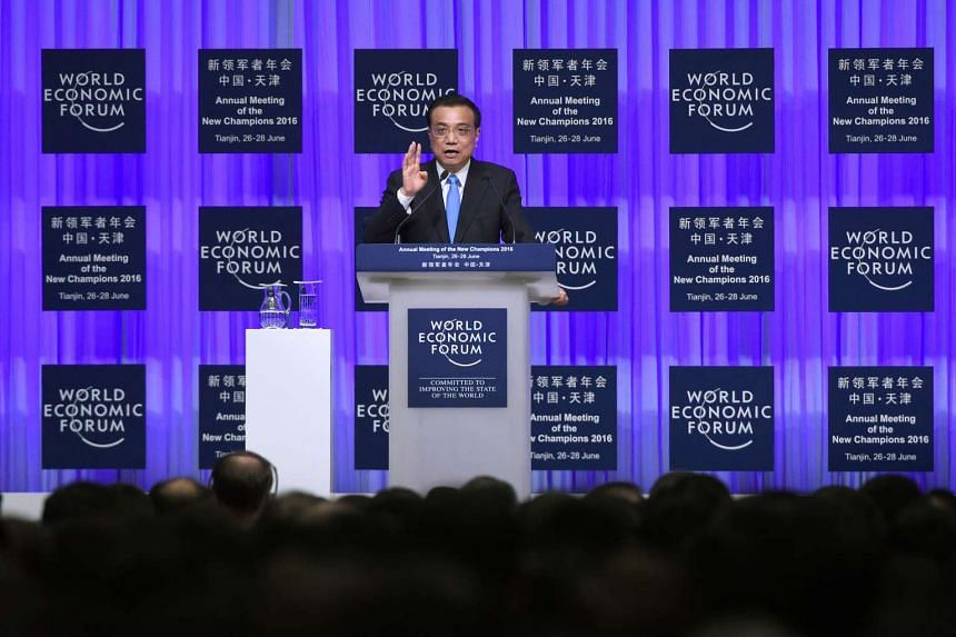 Chinese Premier Li Keqiang speaks on the first day of the World Economic Forum in Tianjin, on June 27, 2016.