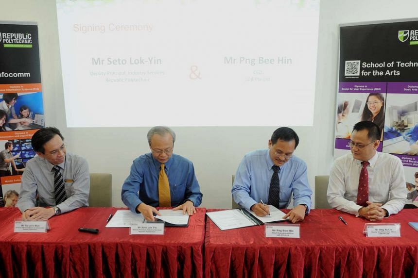 Officials from Republic Polytechnic and LDR sign a Memorandum of Understanding in a partnership to give RP students the opportunity to work with LDR in developing location-based mobile apps.
