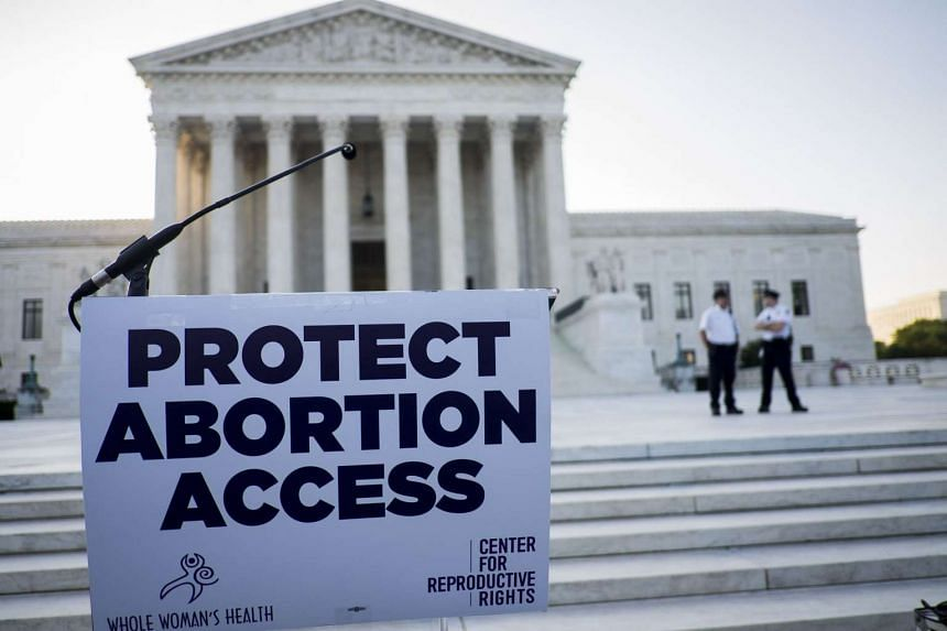 A podium awaits pro-choice speakers in front of the US Supreme Court on June 27, 2016 in Washington, DC.