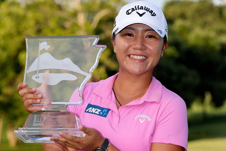Lydia Ko displays the trophy after winning the Walmart NW Arkansas Championship.